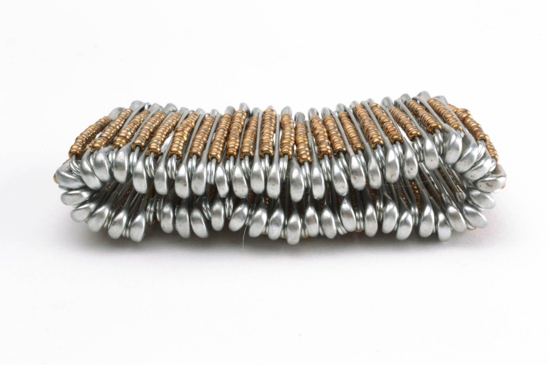 Woman's wrist bracelet made of pins photo 4