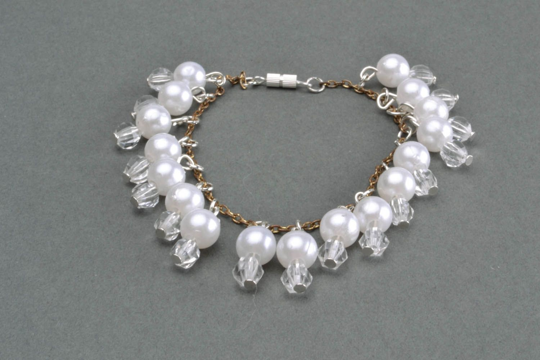Bracelet made of white beads photo 1