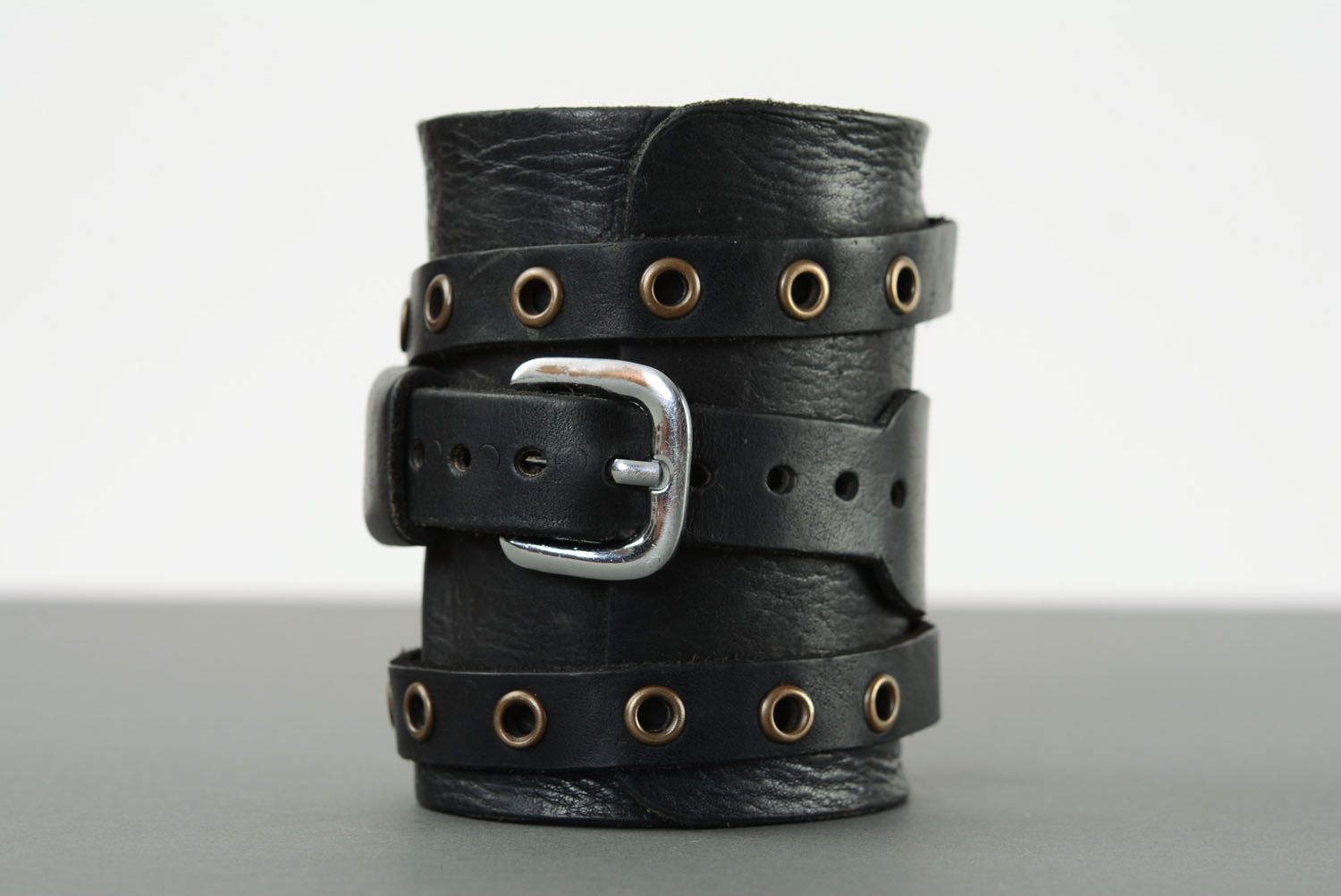 Leather bracelet with metal inserts photo 2