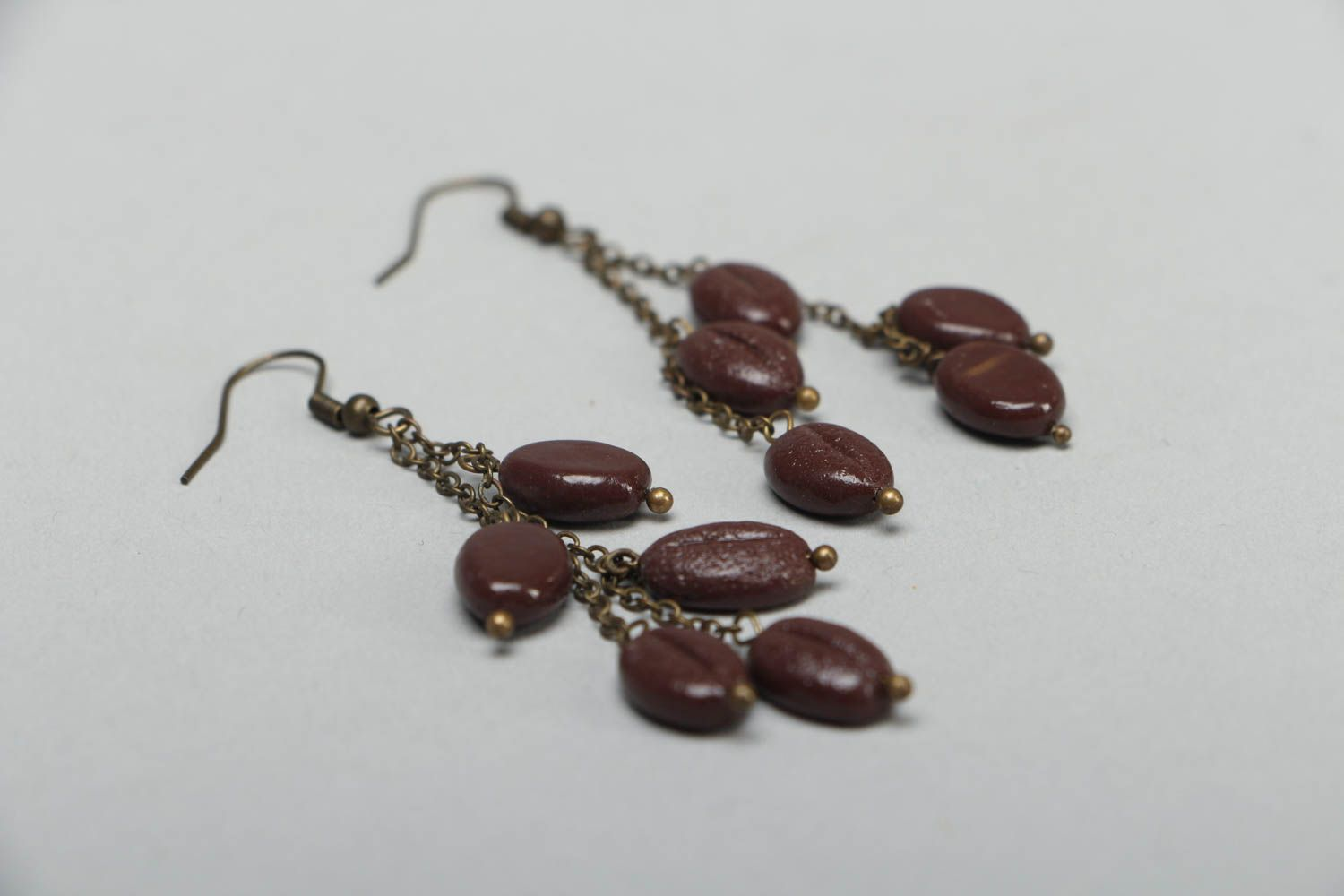 Unusual earrings with plastic charms photo 2