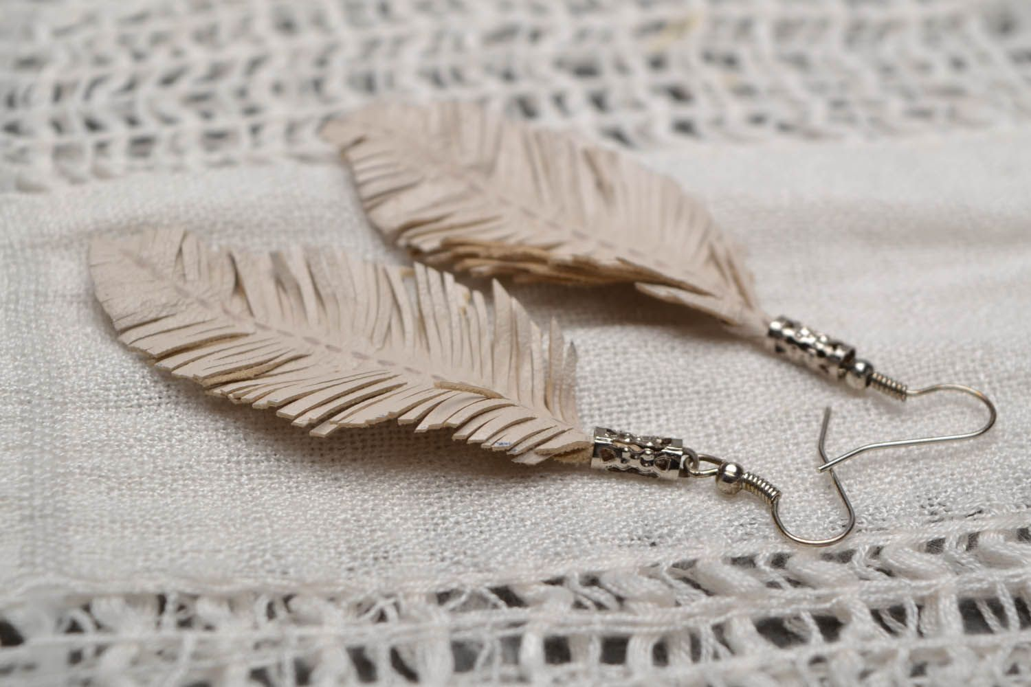 White leather earrings Feathers photo 1