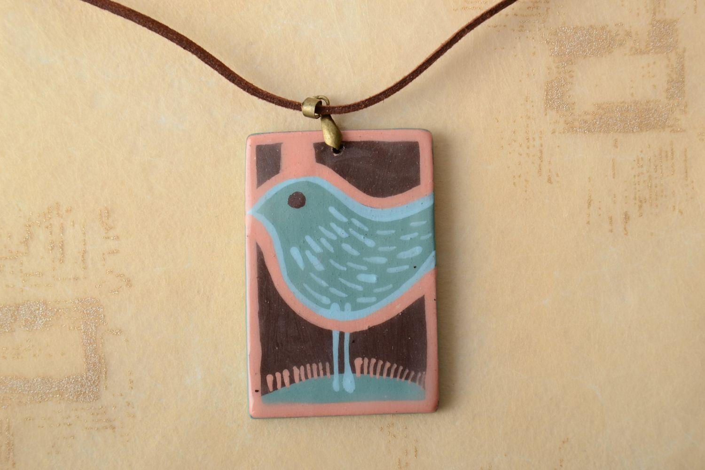 Interesting ceramic pendant on cord photo 1