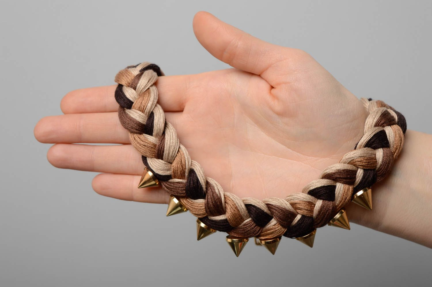 Woven necklace with metal studs photo 4