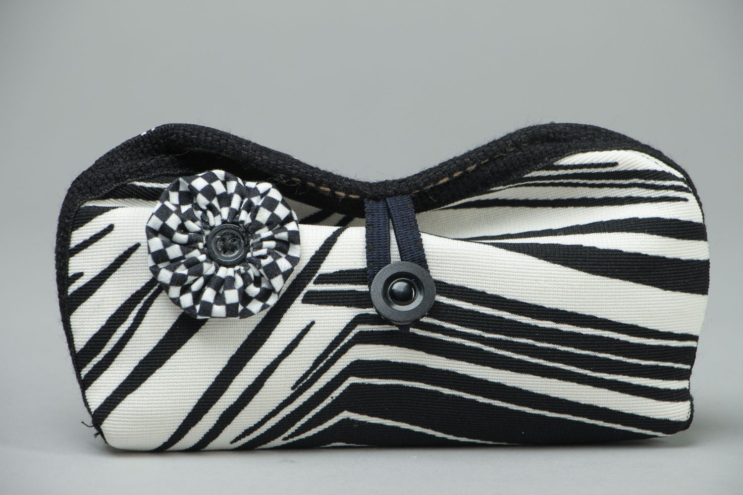 Black and white eyeglass case with button photo 1