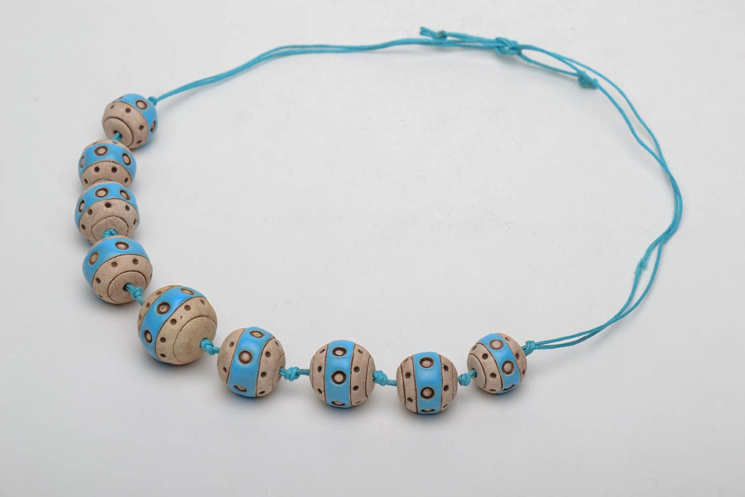 Clay bead necklace with cord photo 3
