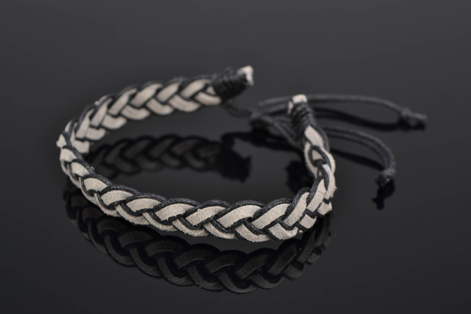 Woven suede bracelet with ties photo 1