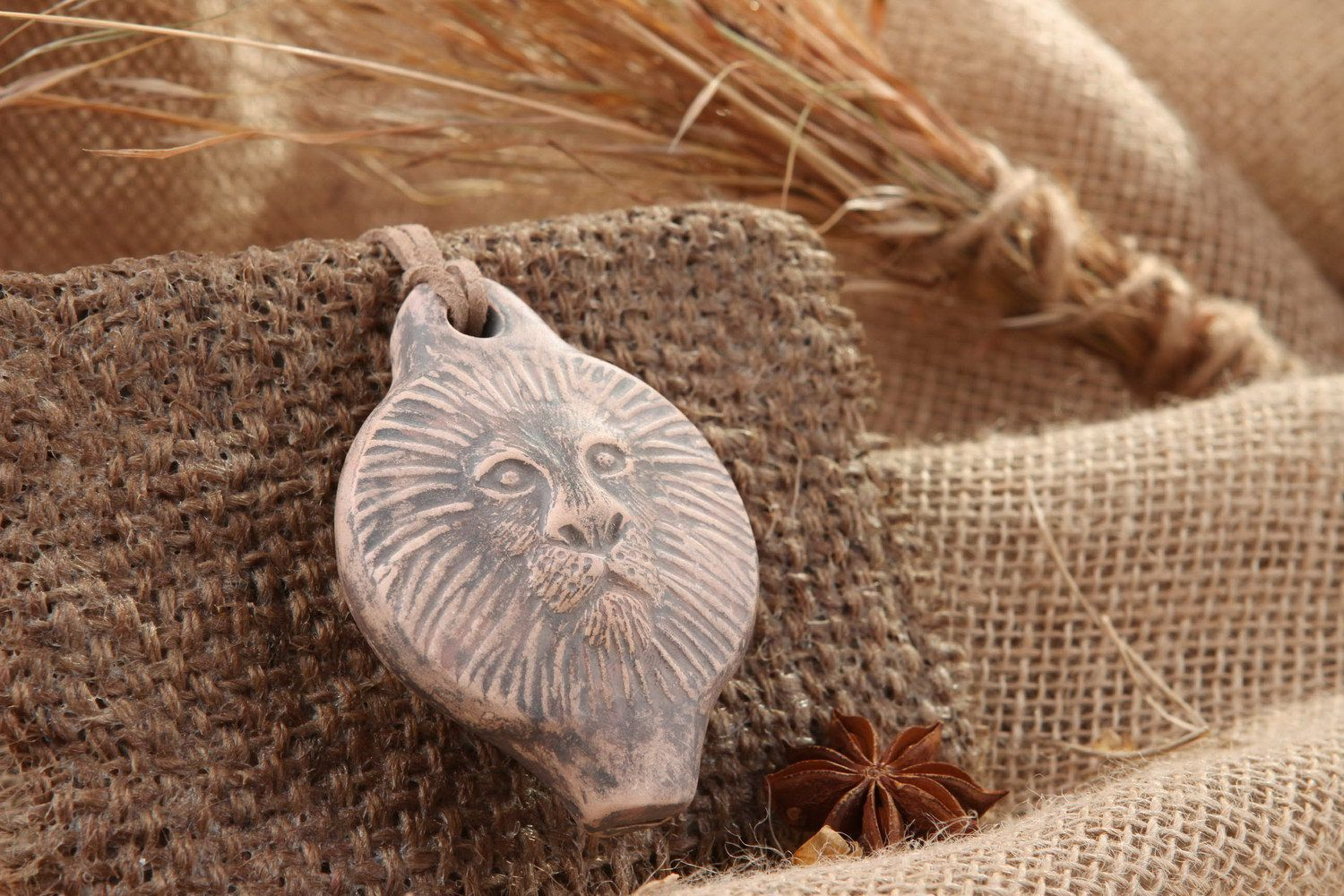 Ceramic tin whistle pendant in the form of lion's head photo 1