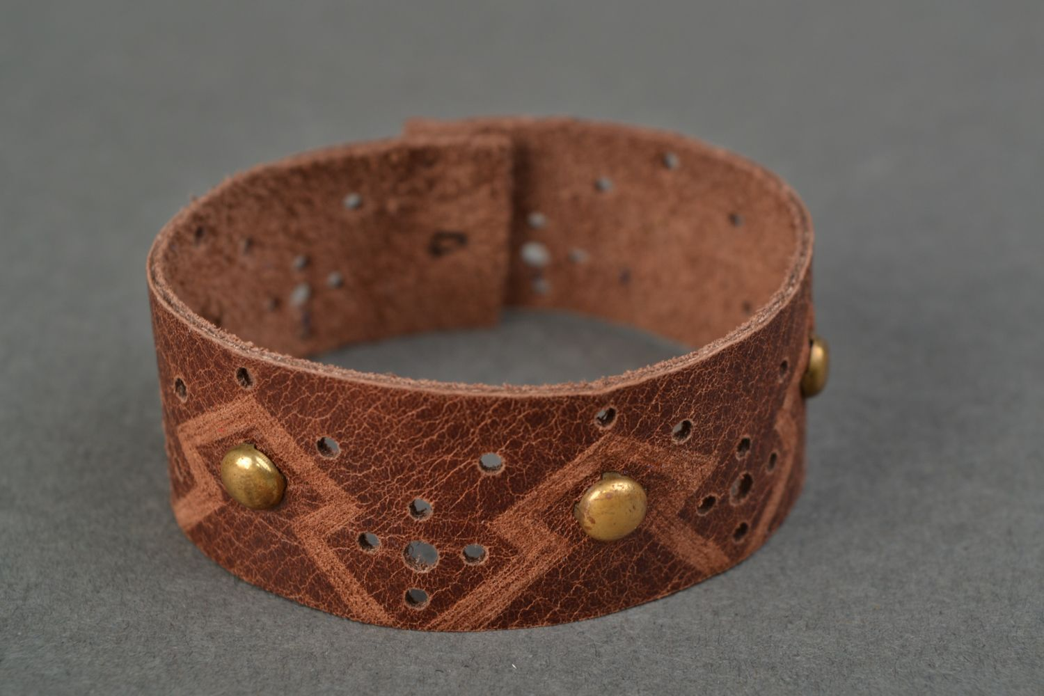 Handmade brown leather bracelet with rivets photo 1