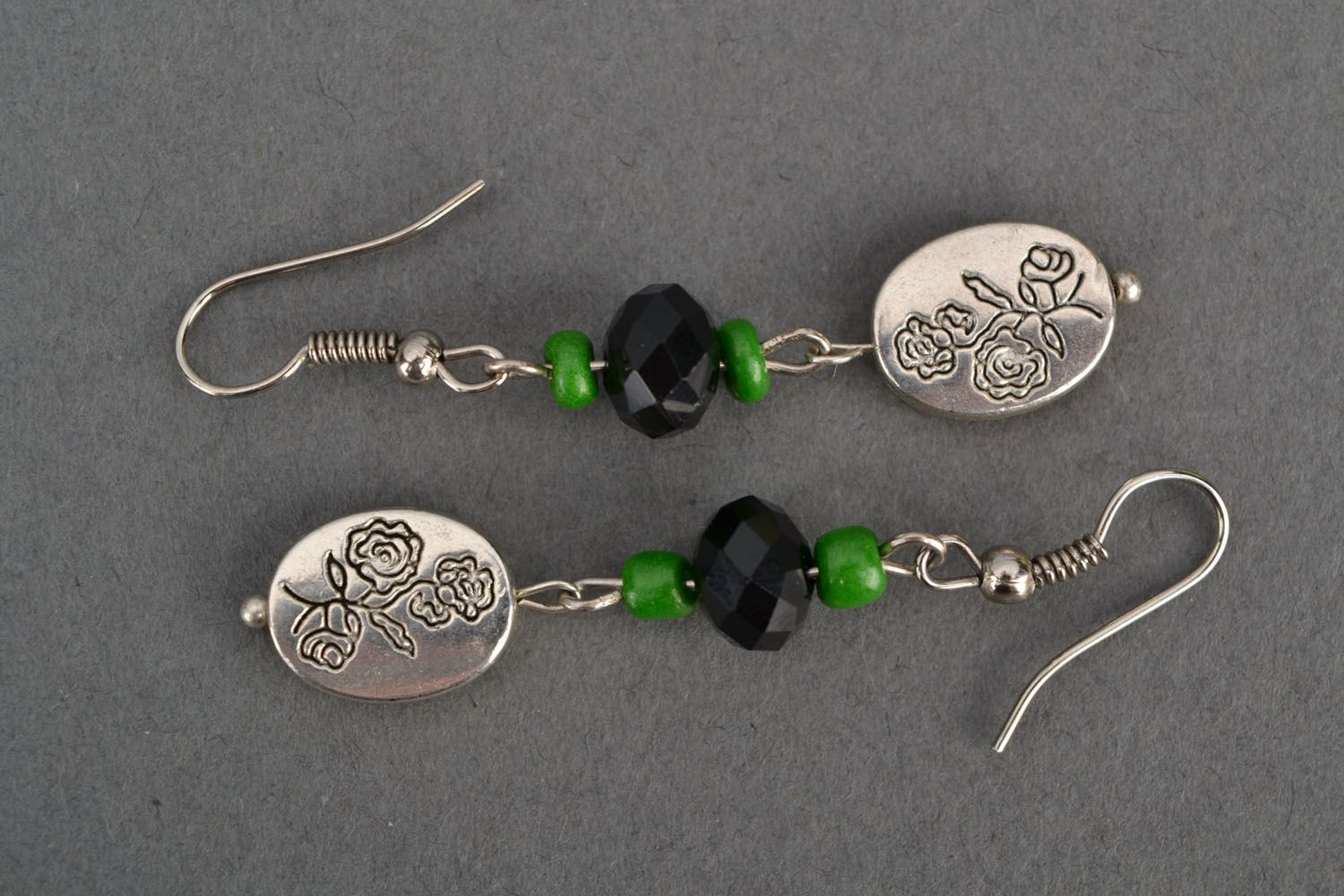 Long earrings with metal charms photo 2