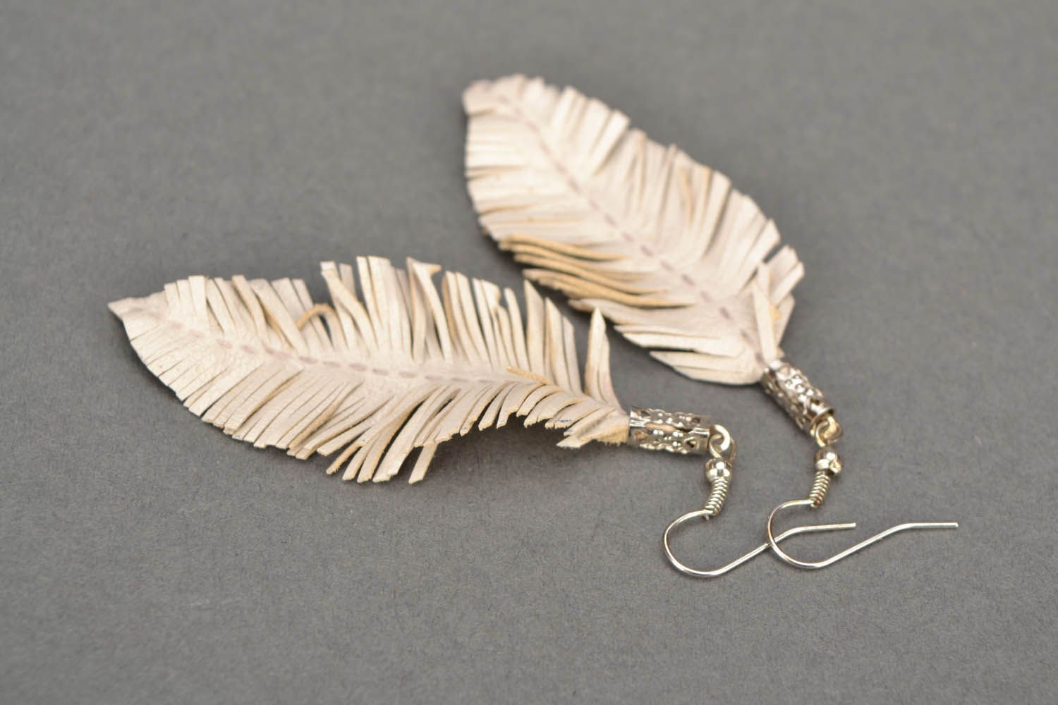 White leather earrings Feathers photo 5