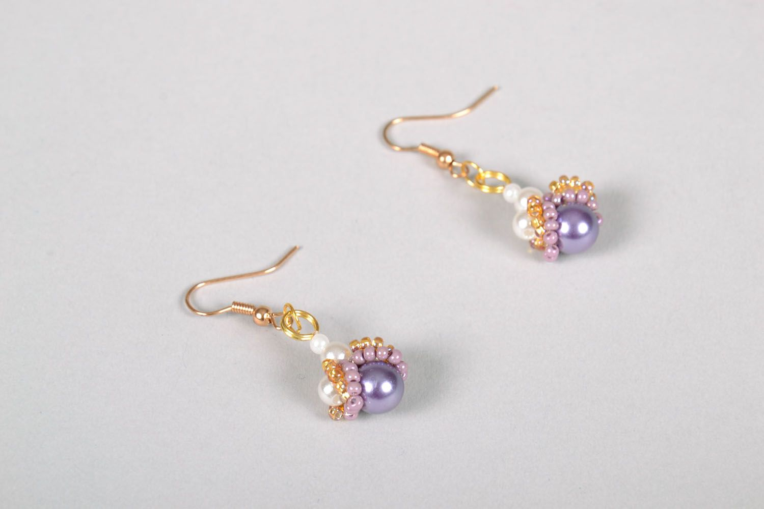 Beaded earrings with charms photo 3