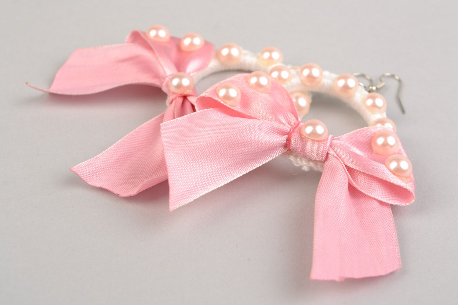 Braided earrings made of plastic rings and threads with pink ribbons present for girlfriend photo 4