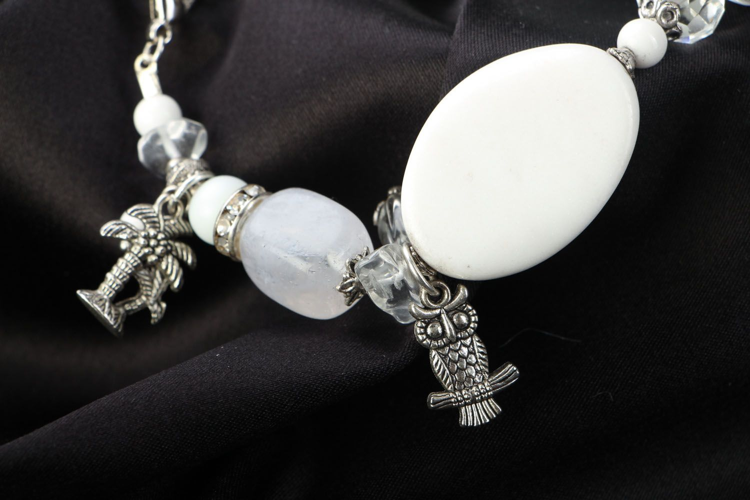 Natural stone bracelet with charms photo 3