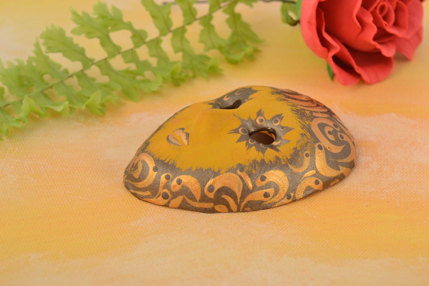 Painted handmade fridge magnet in the shape of a souvenir mask made of clay photo 1