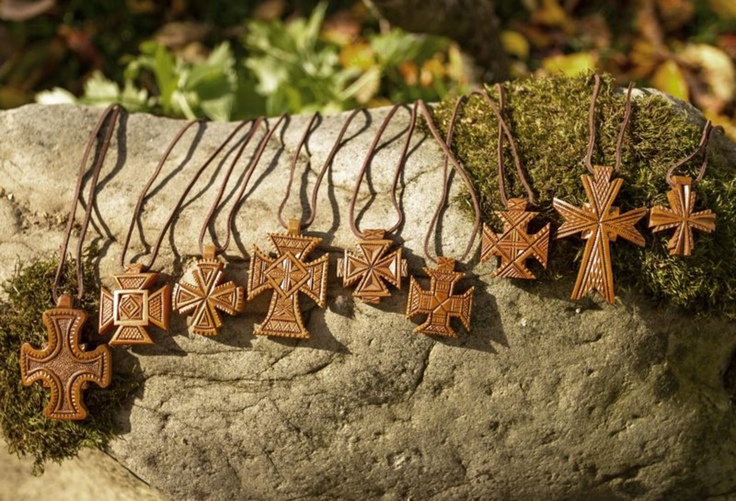 next to skin crosses Sipmle pear wooden cross with ancient symbols - MADEheart.com