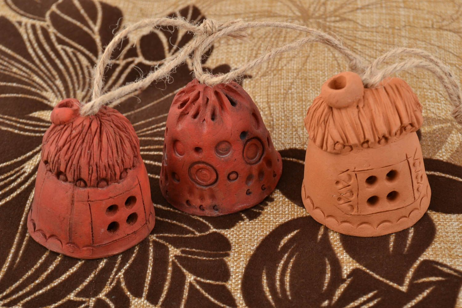 Set of small handmade wall hanging ceramic ethnic bells with cords Houses photo 1