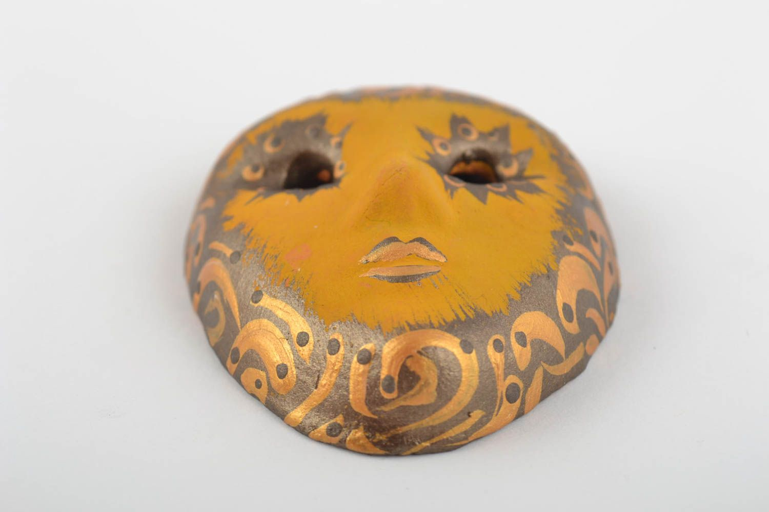 Painted handmade fridge magnet in the shape of a souvenir mask made of clay photo 3