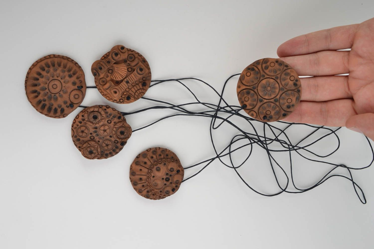 Set of handmade stylish clay pendants of round shape in ethnic style 5 pieces photo 5