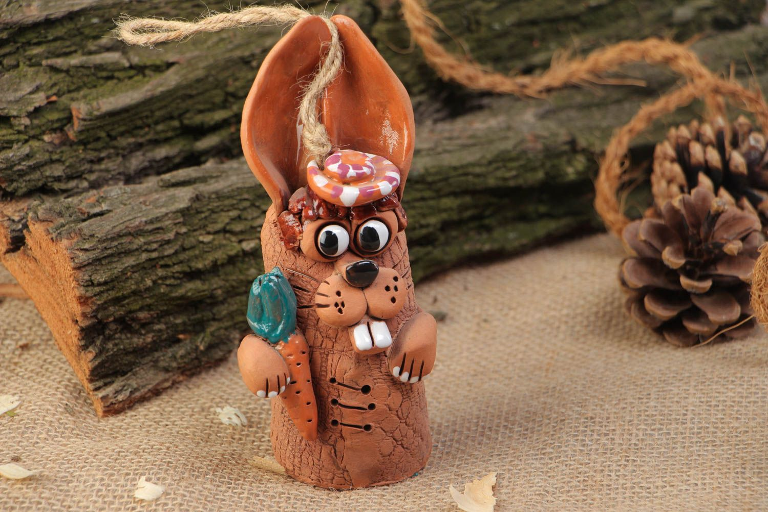 Handmade painted clay bell in the shape of hare for interior decor photo 1