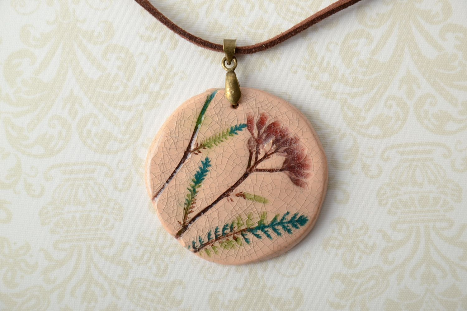 ethnic jewelry Ceramic pendant with stamps of plants  - MADEheart.com