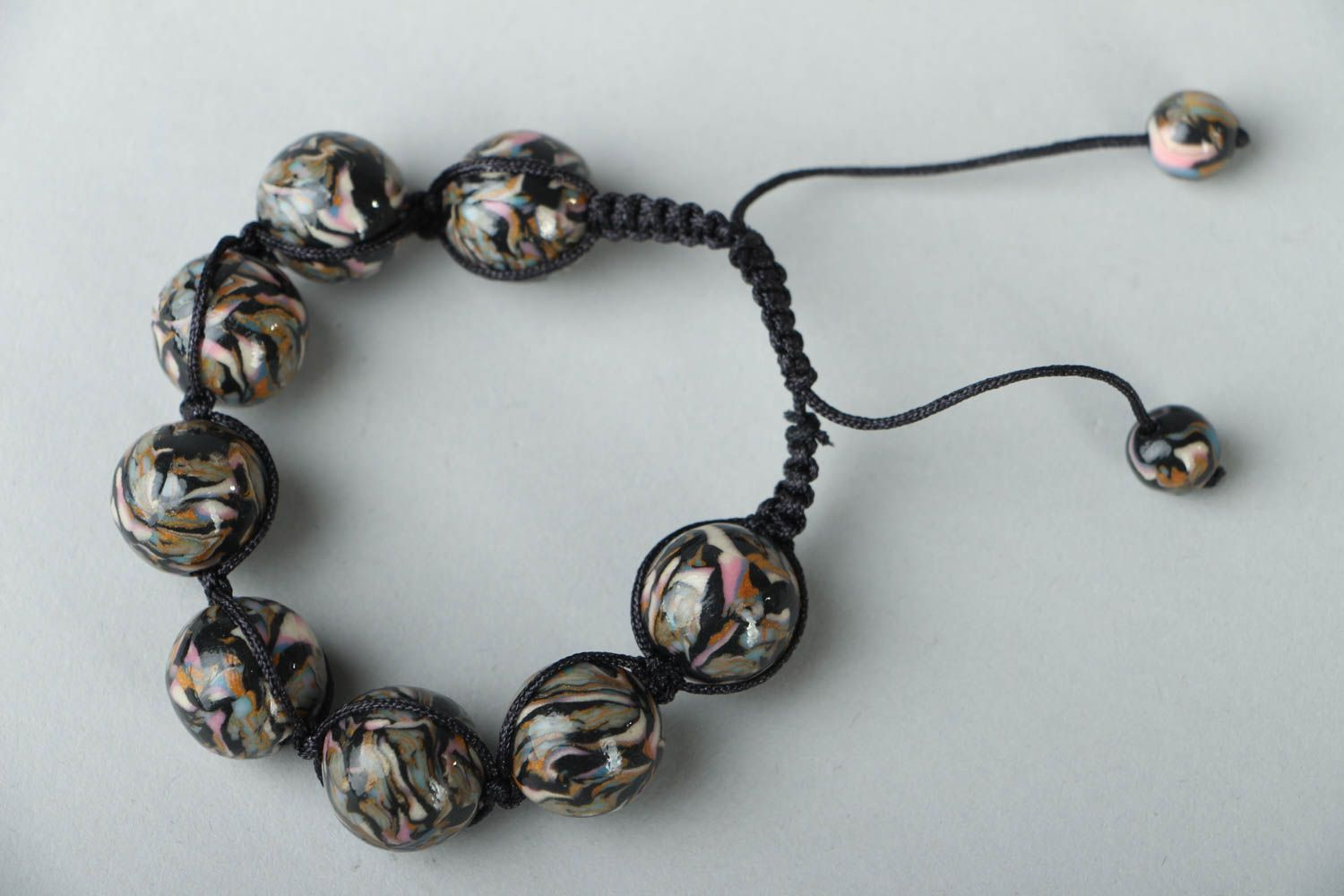 Woven bracelet with polymer clay beads photo 1