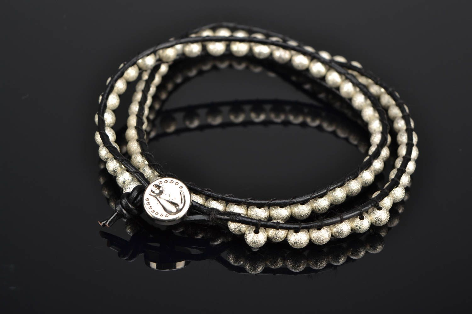 Multirow woven bracelet with metal beads photo 1