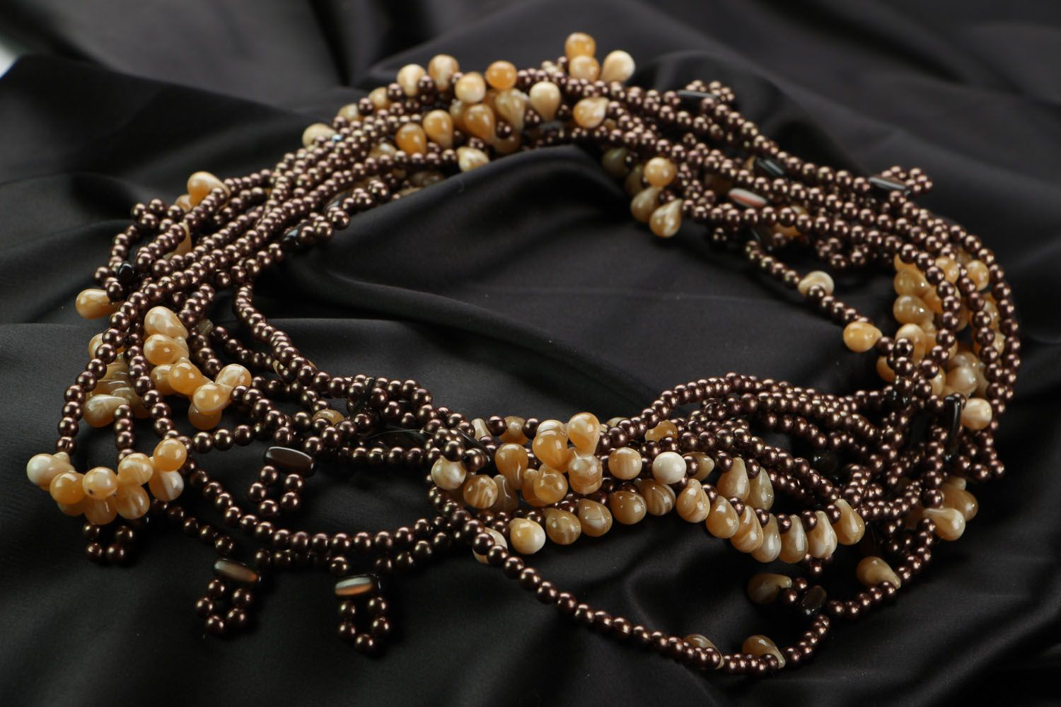Ethnic beaded necklace in brown and beige colors photo 2