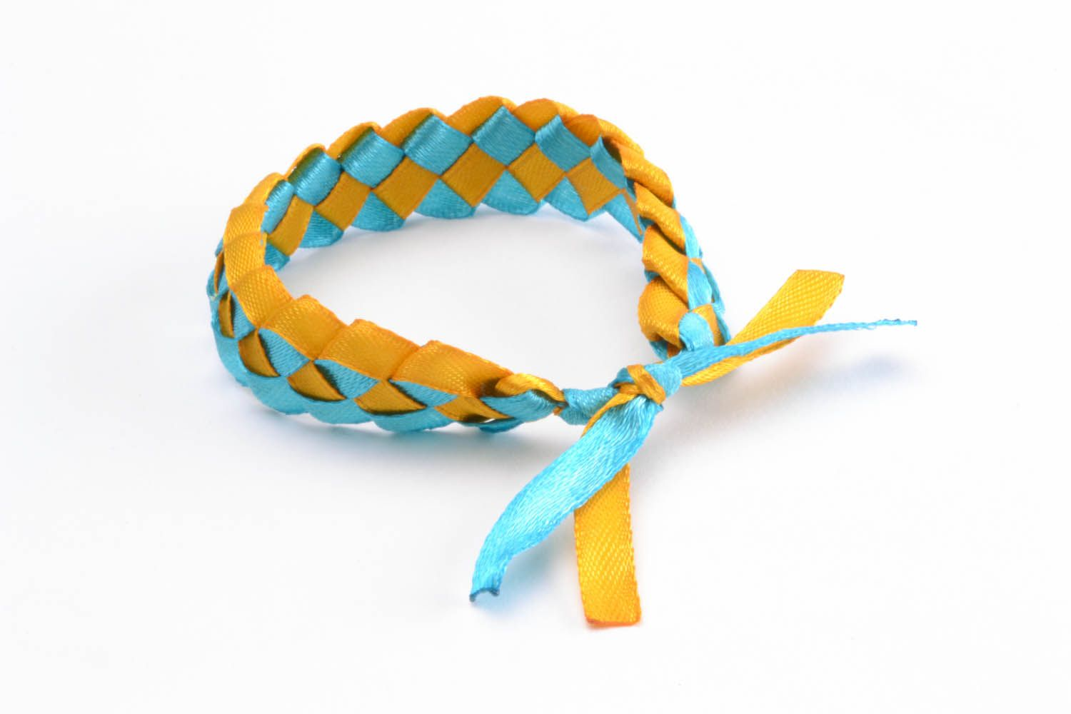 Bracelet made of colourful ribbons  photo 3
