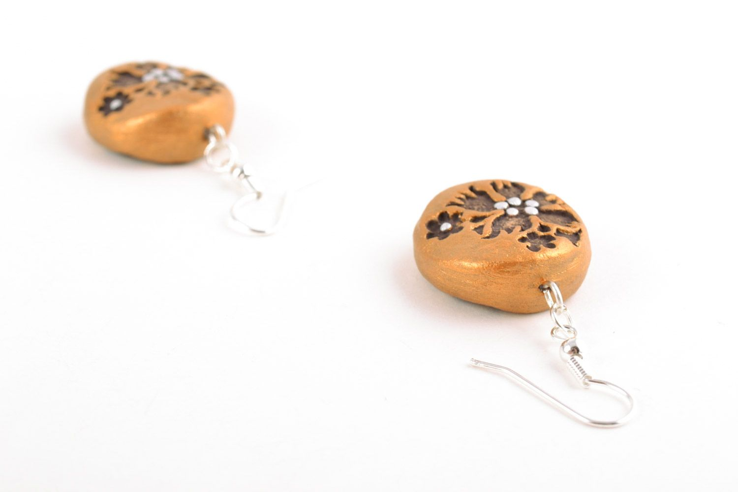 Handmade dangle clay round earrings of gold color with patterns photo 4