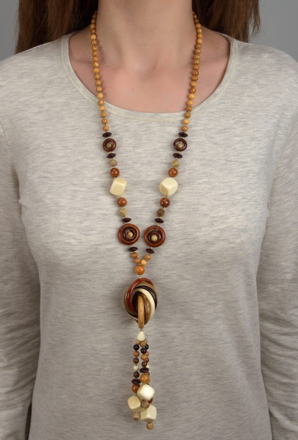 Long beads made of different wood species without clasps photo 5