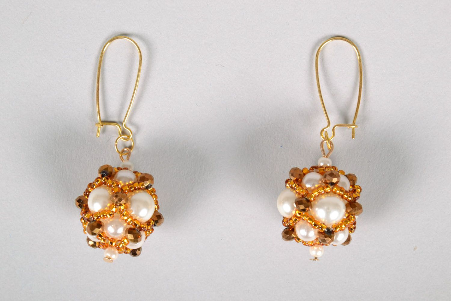 Unusual earrings with charms Golden East photo 2