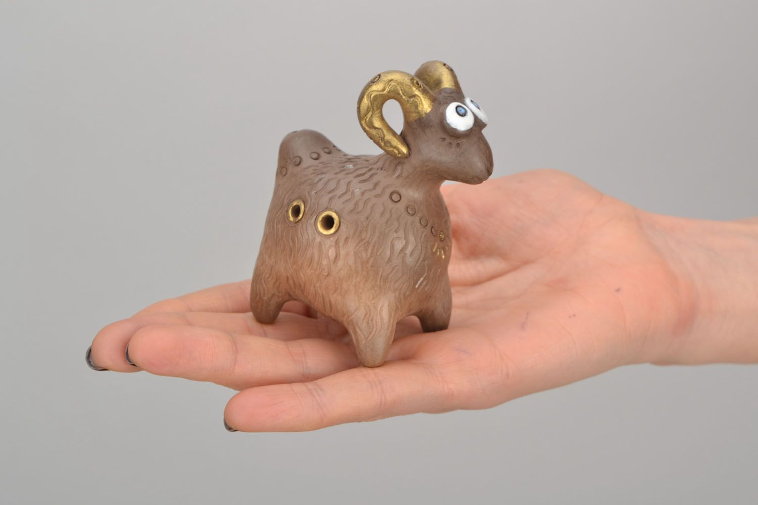 Clay penny whistle in the shape of ram photo 2
