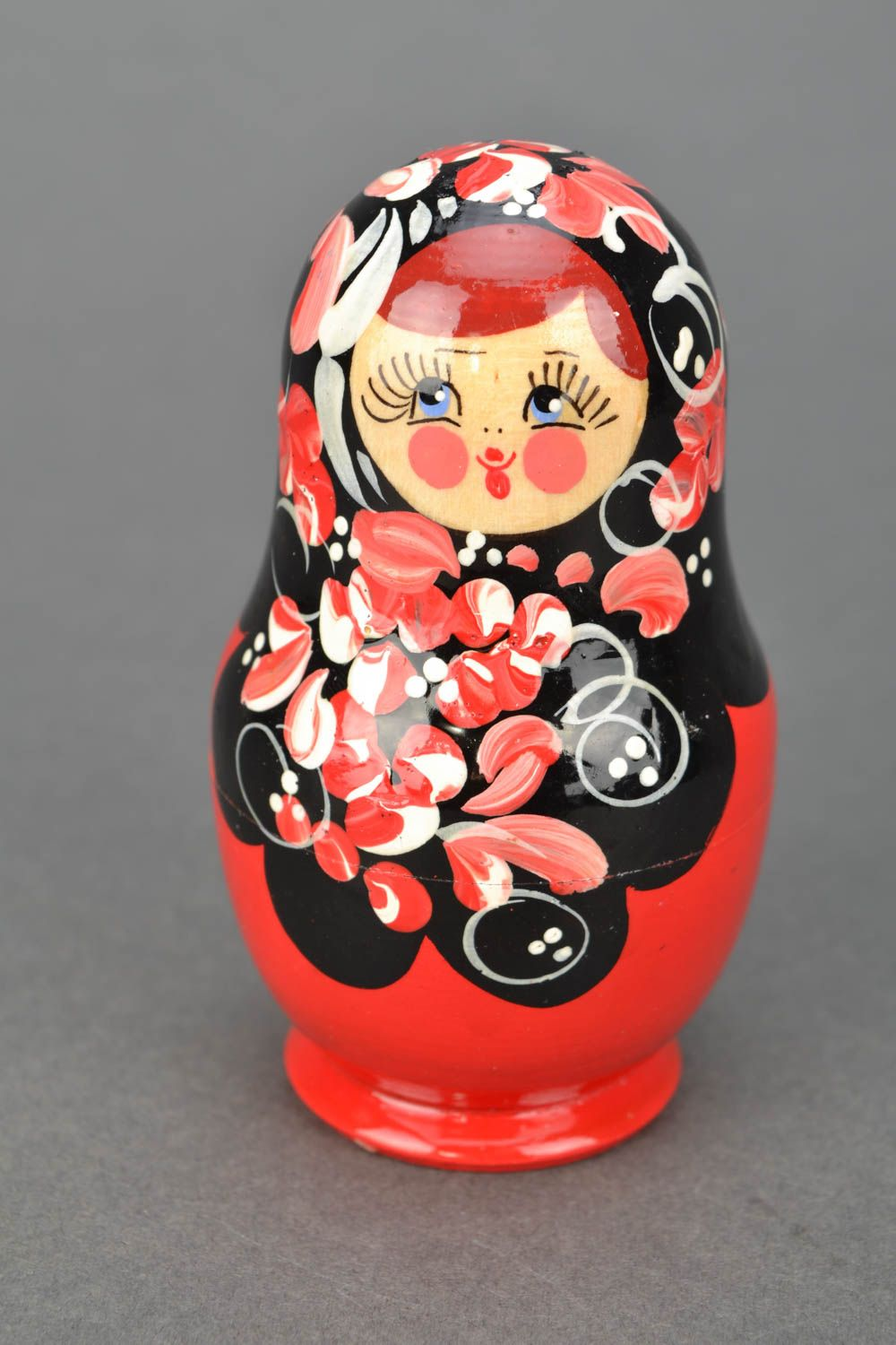 Wooden nesting doll with Petrikov painting photo 1