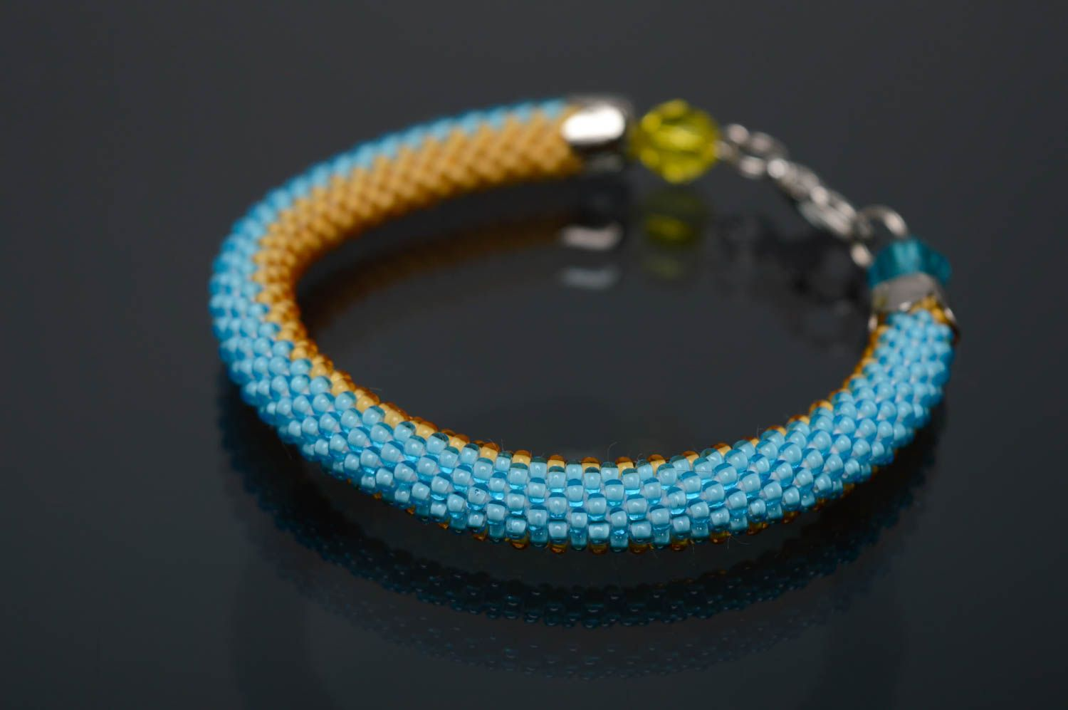 Blue and yellow beaded bracelet photo 1