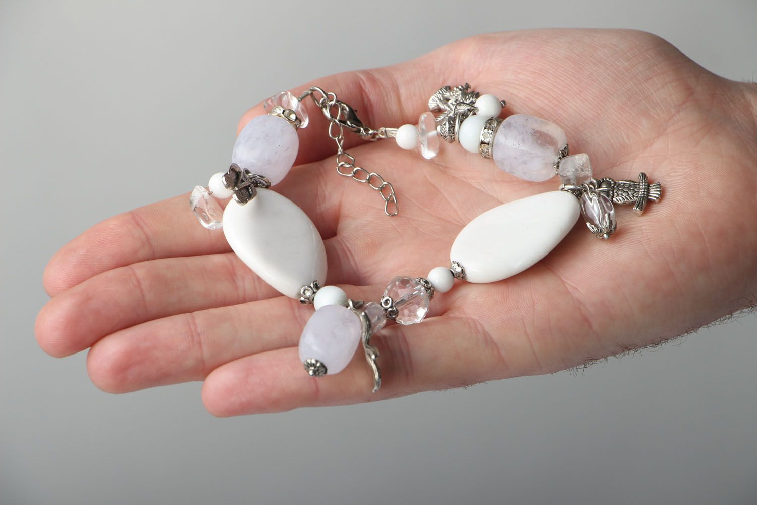 Natural stone bracelet with charms photo 4