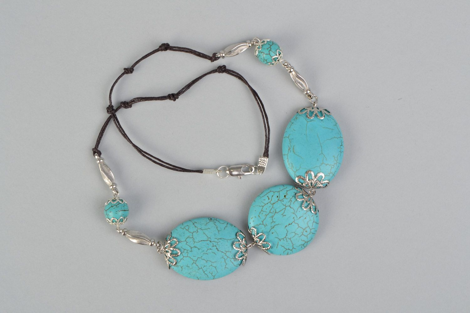 Handmade designer women's necklace with natural turquoise and on waxed cord  photo 3