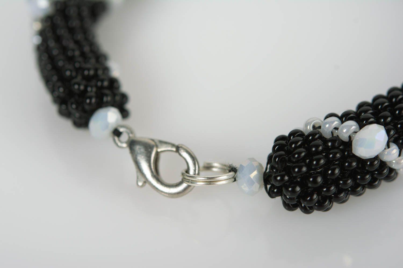 Handmade beaded cord wrist bracelet of white and black colors for women photo 5