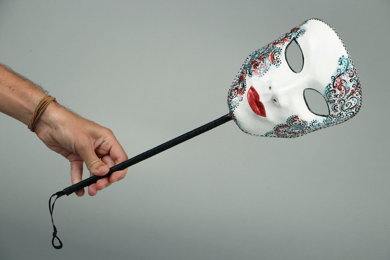 masks Carnival mask with a wooden handle