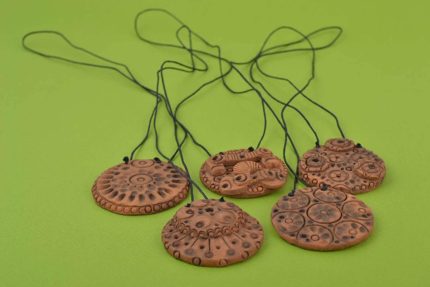 Set of handmade stylish clay pendants of round shape in ethnic style 5 pieces photo 1