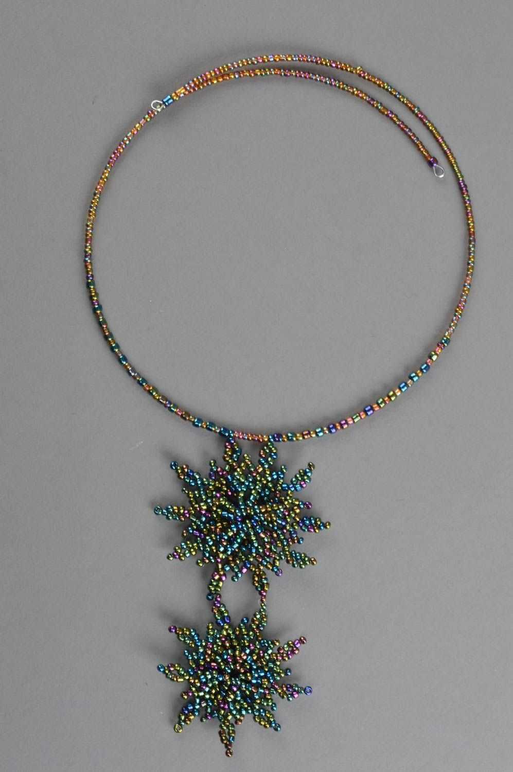Handmade woven beaded thin necklace with stars on a fishing line photo 2