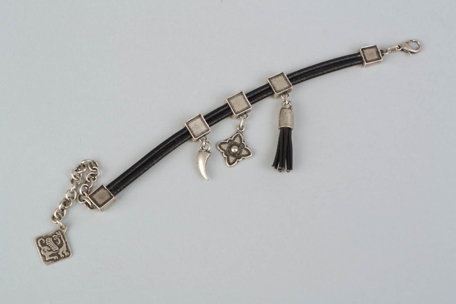 Metal bracelet with cord and charms photo 3
