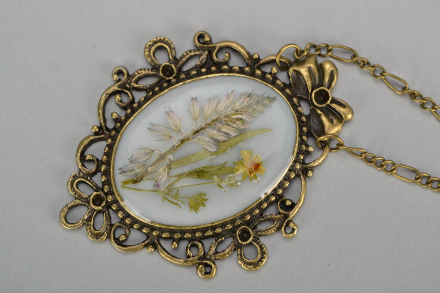 Locket with dry flowers photo 4