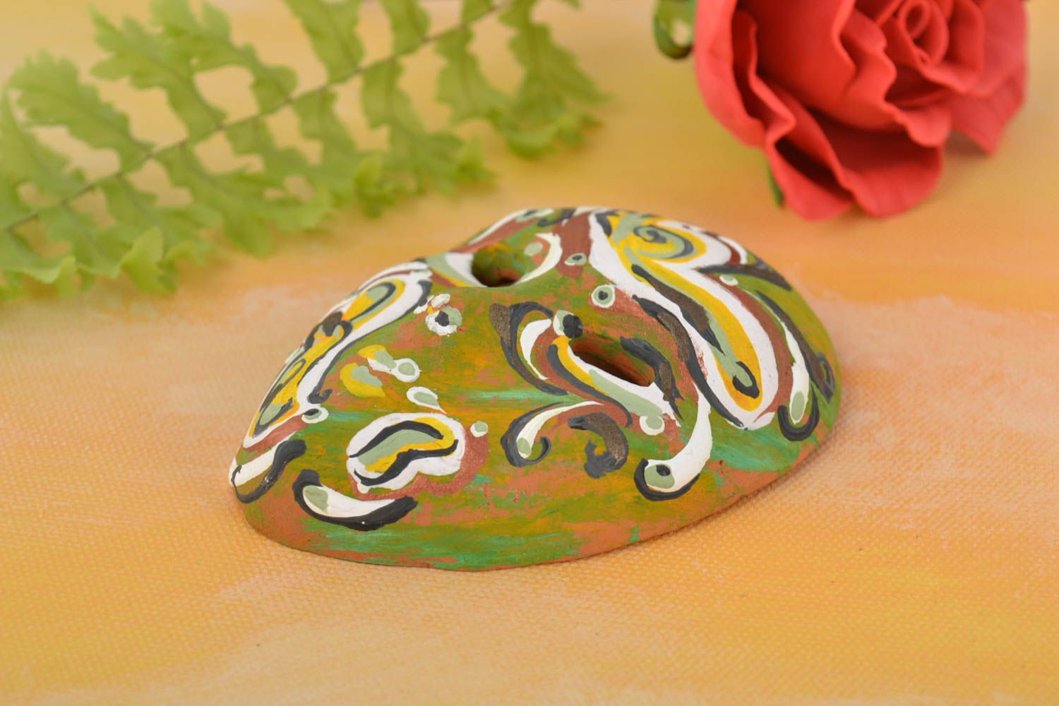 Handmade bright fridge magnet in shape of carnival mask made of clay  photo 1