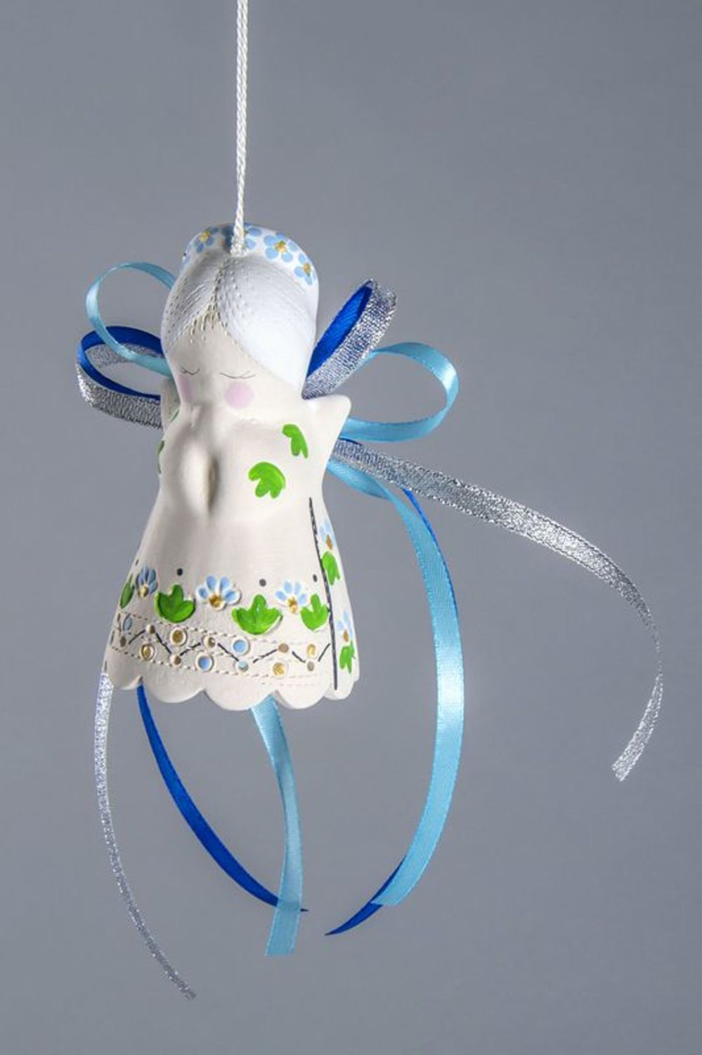 Ceramic angel-bell with ribbons photo 1