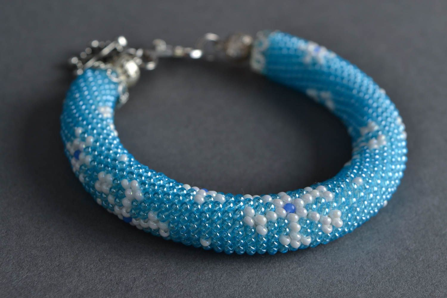 Beautiful handmade woven beaded cord bracelet of blue color with charm Snowflake photo 1