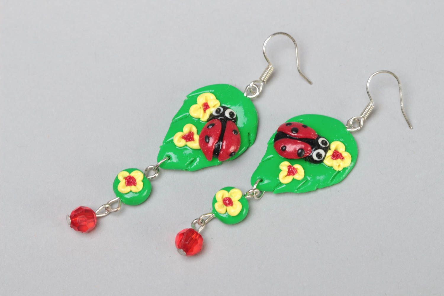 Handmade bright green long dangling polymer clay earrings with ladybugs photo 2