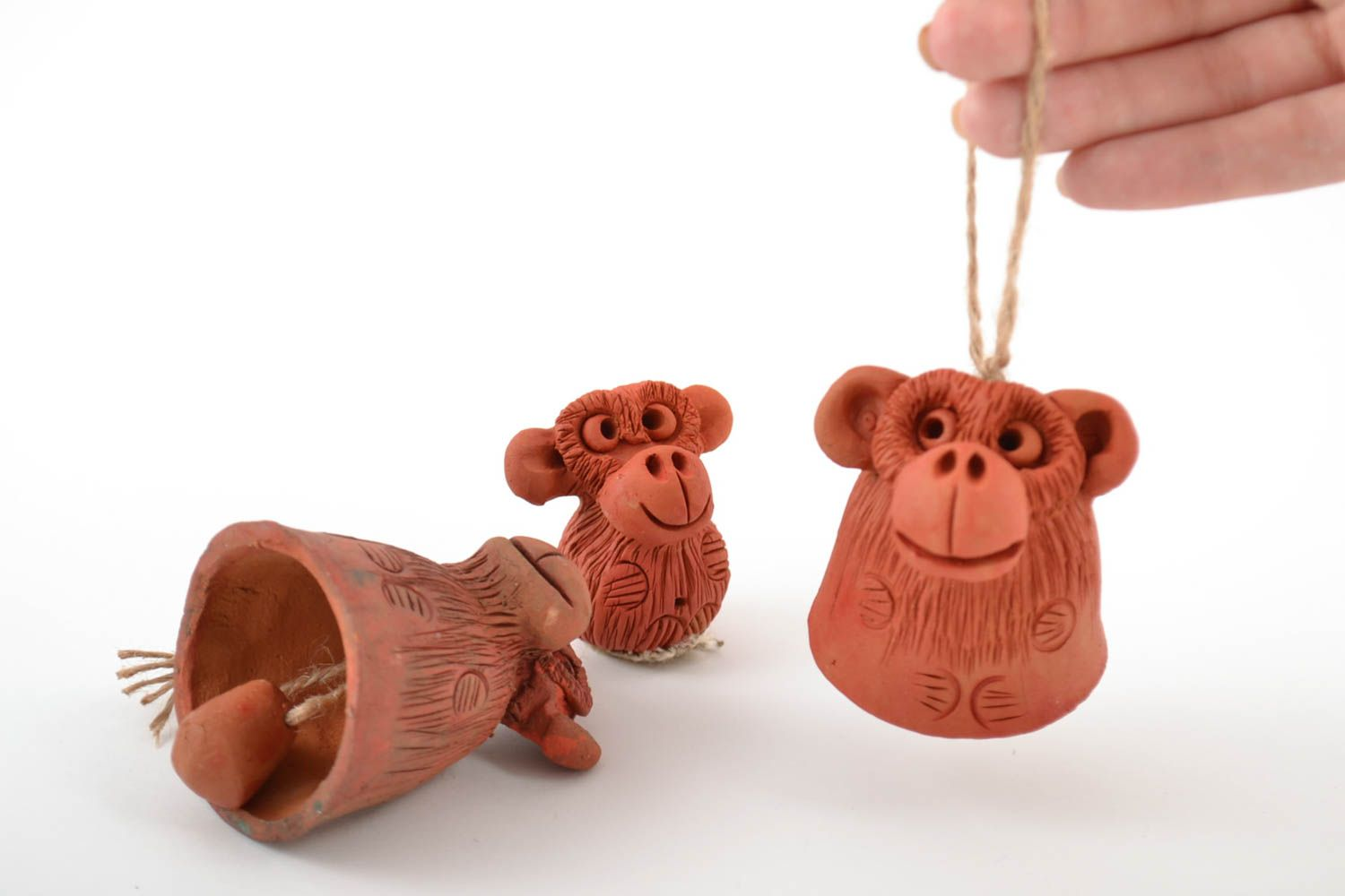 Set of handmade ceramic bells and figurine in the form of monkeys for home decor photo 2