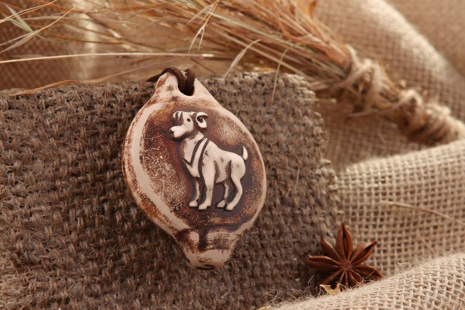 Tin whistle pendant made of clay Aries photo 1