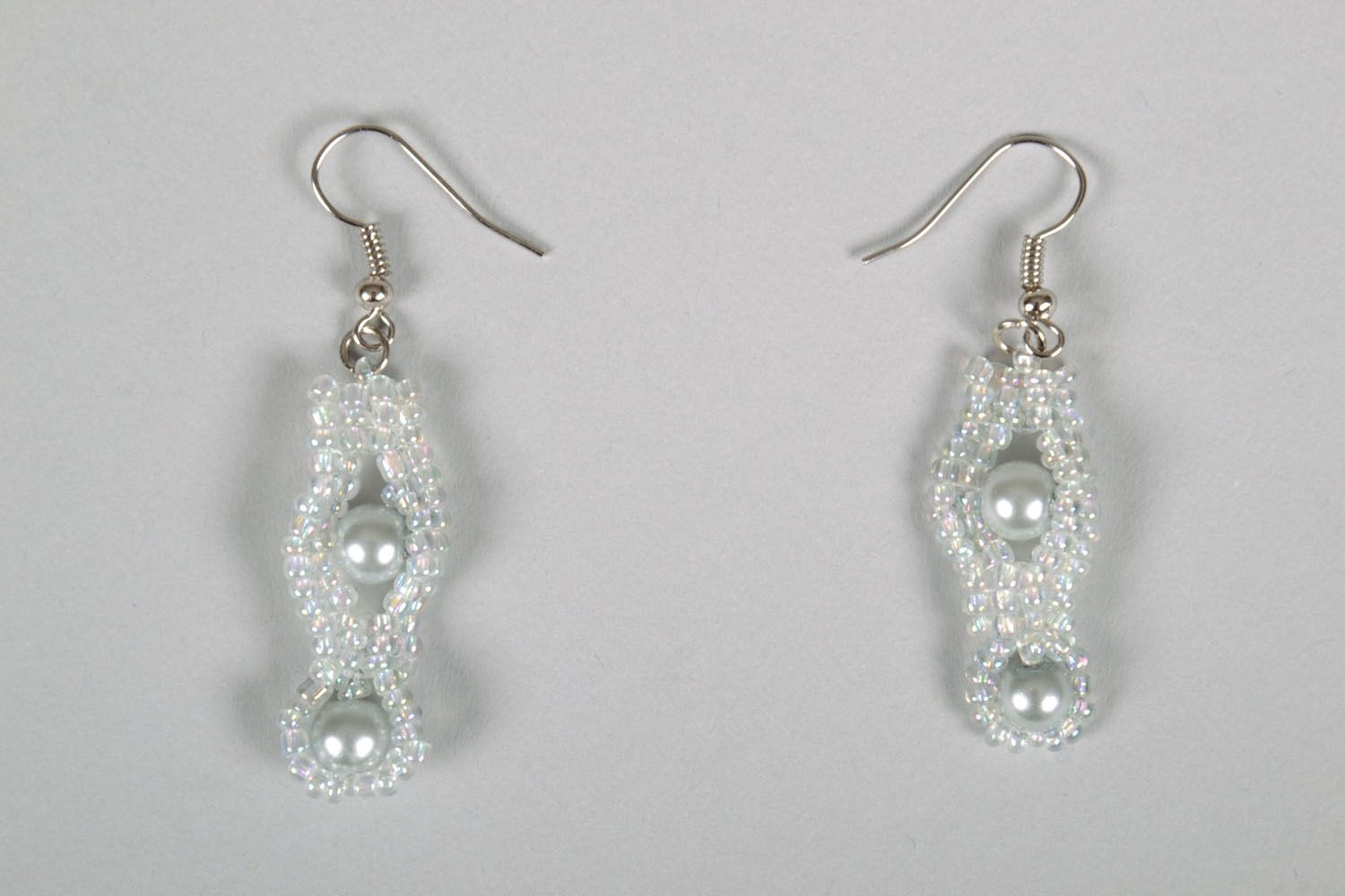 White earrings with artificial pearls photo 2