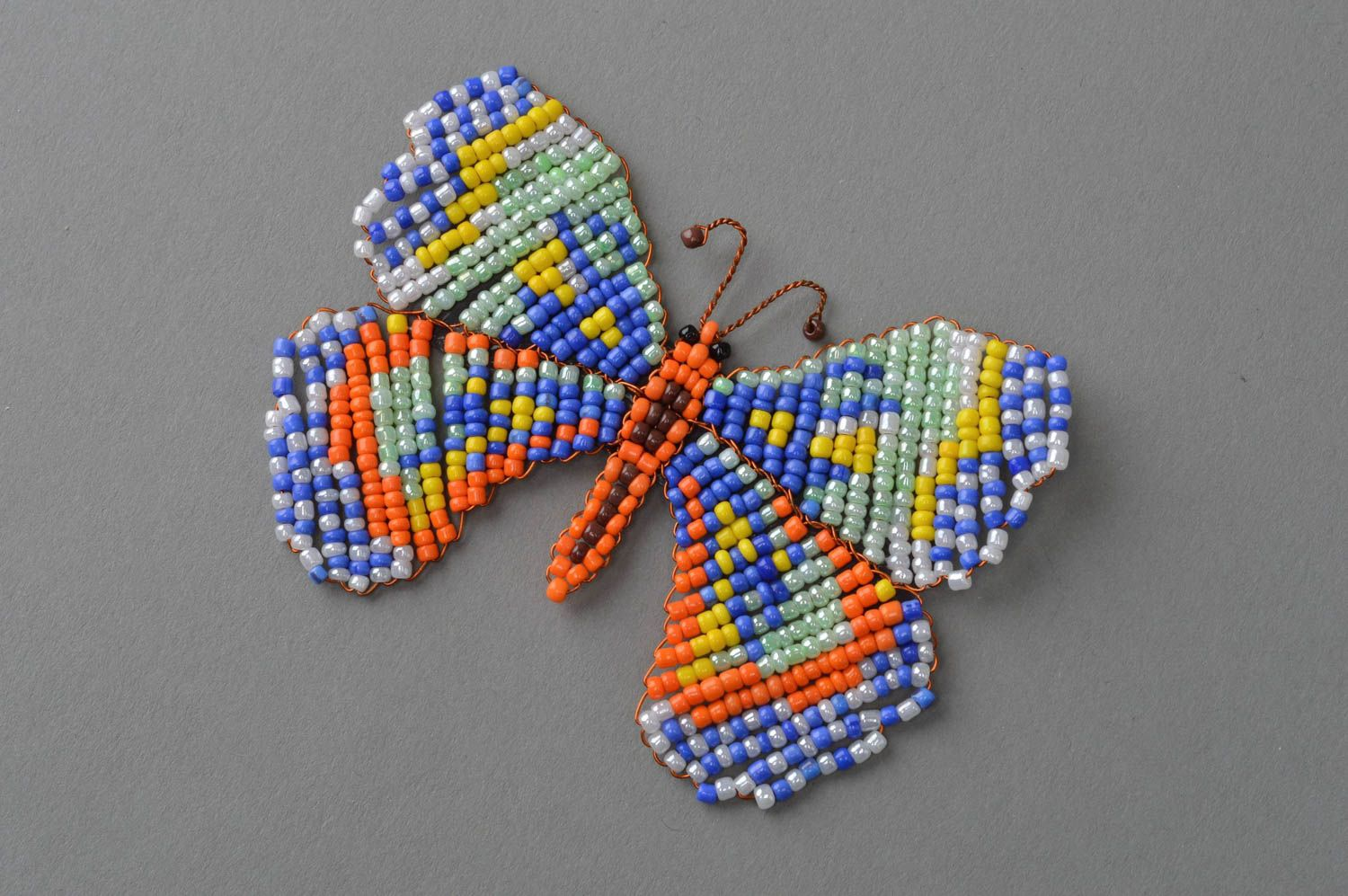 Unusual handmade woven magnet-butterfly on the fridge made of beads photo 2